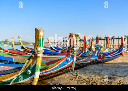Mandalay, Myanmar boats on the Taungthaman Lake in front of U Bein Bridge. - Stock Photo