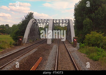 A steel box girder bridge spanning the Thames with two lines going through it and a steel superstructure - Stock Photo