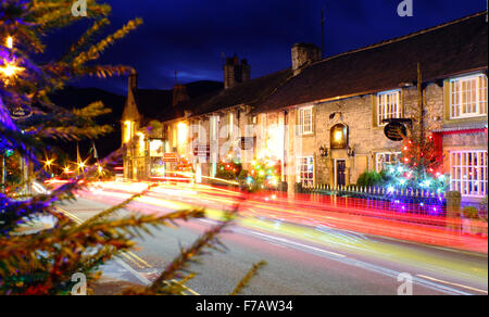 Decorated Christmas trees line the main street in Castleton; a traditional British village in the Peak District, - Stock Photo