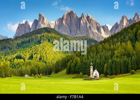 St Johann Church, Santa Maddalena, Tyrol, Dolomites Mountains landscape, Italy - Stock Photo