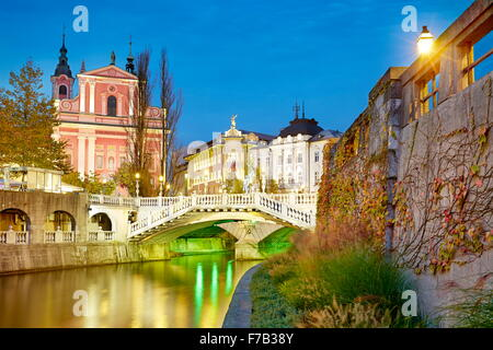 Ljubljana, view at bridge and the Franciscan Church, Slovenia - Stock Photo