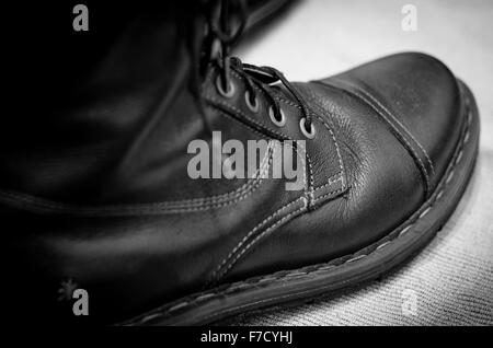 Close up of black leather Art Company biker style boot - Stock Photo