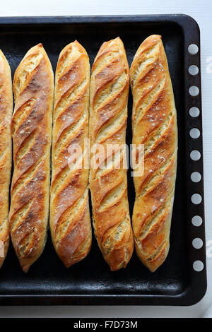 fresh baquettes  on tray, top view - Stock Photo