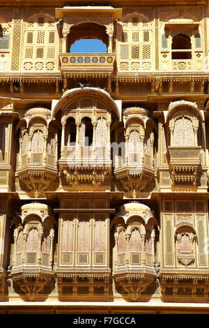 Jaisalmer - decorated carvings of facade in old haveli (mansion), Jaisalmer, Rajasthan, India - Stock Photo