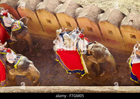 Indian Elephant carrying tourists to the Amber Fort, Amer 11km near of Jaipur, Rajasthan, India - Stock Photo