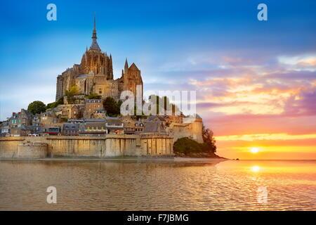 Mont Saint Michel at sunset, Normandy, France - Stock Photo
