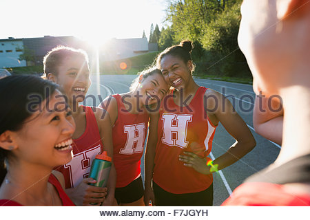 Female high school track and field team bonding - Stock Photo