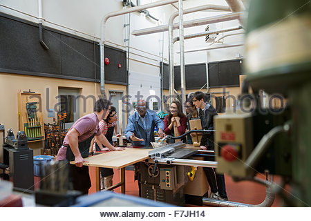 High school students and teacher in woodworking class - Stock Photo