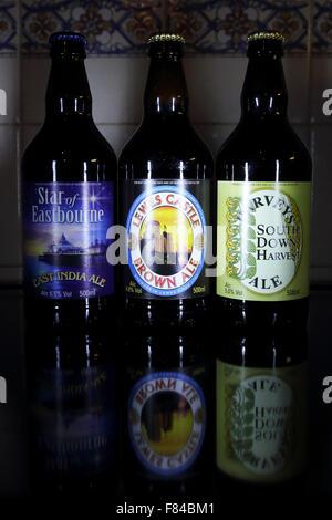 Bottles of beer brewed by Harveys Brewery of Lewes, England. - Stock Photo