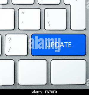 Laptop keyboard and blue key 'UPDATE' on it. Square format. - Stock Photo