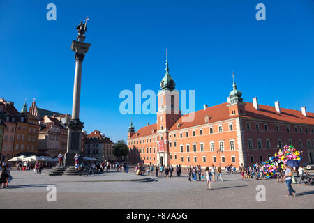 Castle Square in Warsaw's Old Town, Zygmunt's column on the left and Royal Castle on the right, Poland - Stock Photo
