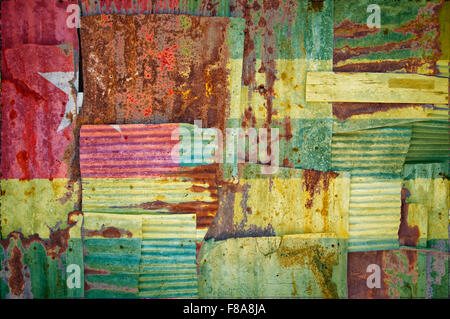An abstract background image of the flag of Togo painted on to rusty corrugated iron sheets overlapping to form - Stock Photo