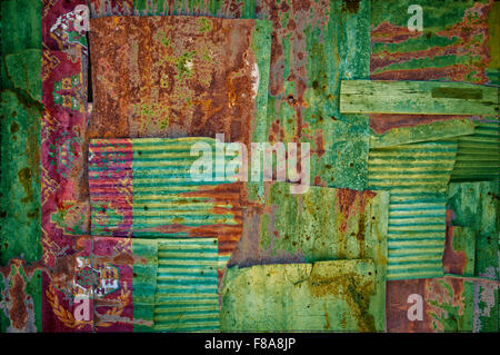 An abstract background image of the flag of Turkmenistan painted on to rusty corrugated iron sheets overlapping - Stock Photo