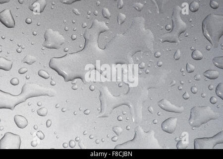 Close up image of water drops on metallic surface - Stock Photo