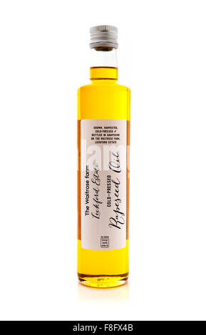 Bottle Of Waitrose Farm Cold Pressed Rapeseed Oil on a White Background - Stock Photo