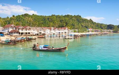 Thailand - Phi Phi Island, Phang Nga Bay, long tail boats at the port - Stock Photo