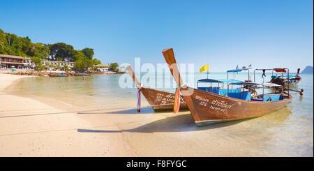 Thailand - Phi Phi Island, Phang Nga Bay, long tail boats on the beach - Stock Photo