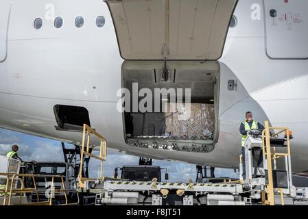 Ground crew loading A380 jet aircraft at airport - Stock Photo