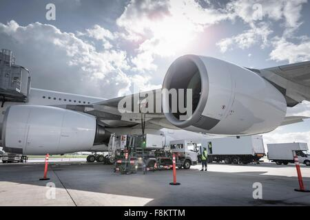 A380 aircraft being refuelled at airport - Stock Photo