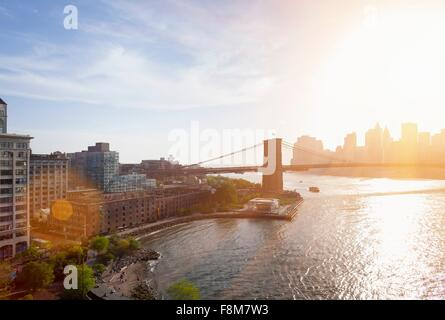 Elevated view of sunlit Brooklyn Bridge, New York, USA - Stock Photo