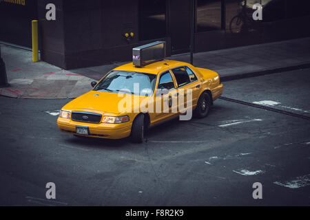 New York City - September 19: Manhattan Yellow Cab and makes turning at left on 19 September 2015. - Stock Photo