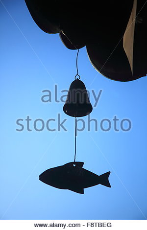 wind chime hanging under the eaves - Stock Photo
