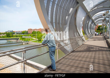 Man at the viewpoint in the Perrault bridge. Madrid Rio, Madrid, Spain. - Stock Photo