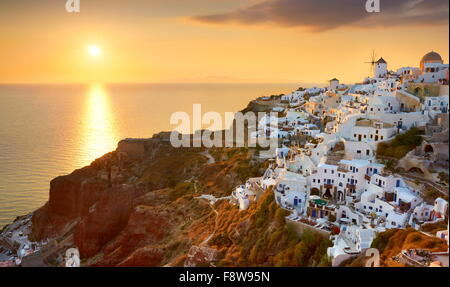 Cityscape view at the sunset in Oia Town, Santorini Island, Greece - Stock Photo