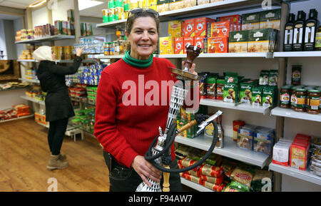 Sigmaringen, Germany. 07th Nov, 2015. Shop owner Zainab Shami poses inside her grocery shop 'Damaskus' with a shisha - Stock Photo