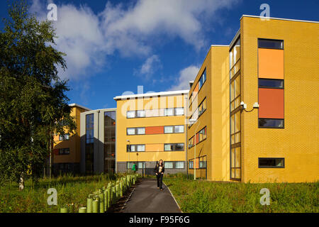 Mackinder and Stenton halls of residence, University of Reading, Berkshire. Student walking a long a path in front - Stock Photo