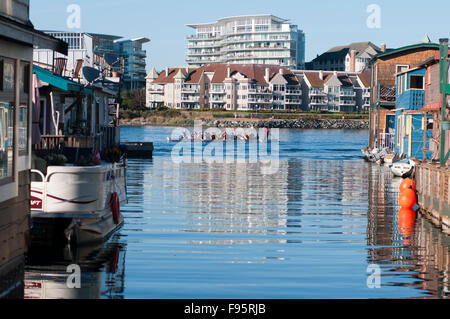 Fisherman's Wharf in Victoria, BC, is home to dozens of colorful houseboats and is a favorite tourist spot. Here, - Stock Photo