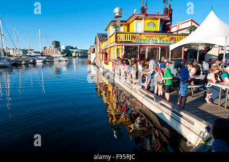 Fisherman's Wharf in Victoria, BC, is home to dozens of colorful houseboats and is a favorite tourist spot, especially - Stock Photo