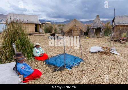 Local residents of floating reed islands of Uros, Lake Titicaca, Peru - Stock Photo