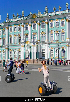 Tourists on Segways at The State Hermitage Museum's Winter Palace in St. Petersburg, Russia. - Stock Photo