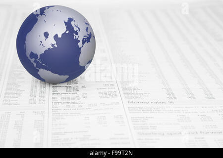 Map of the world globe on a News paper Stock market financial pa - Stock Photo