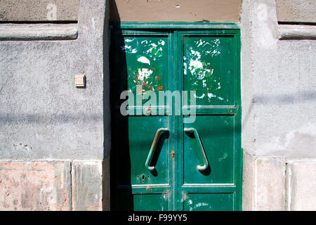 Abandoned building with a green door - Stock Photo