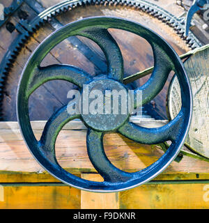 Cast iron valve - part of old wooden watermill - Stock Photo