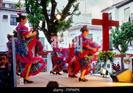 Dia de la Cruz, floral cross and dancers, in Plaza Larga,Albaicin quarter, Granada, Andalucia, Spain - Stock Photo
