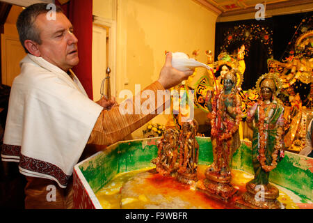 Celebration of Diwali festival in an ISKCON temple. Abhishek ritual. - Stock Photo