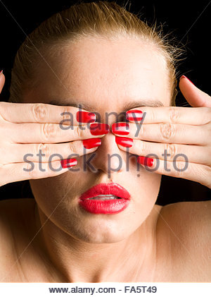 Young Woman Covering Face With Her Hands - Stock Photo