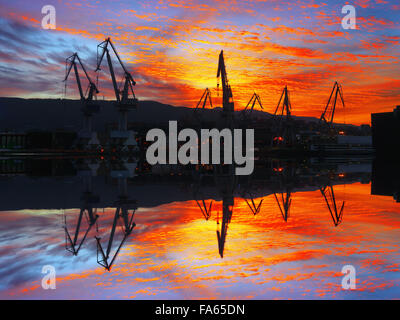 Cranes in Sestao at beautiful sunset - Stock Photo