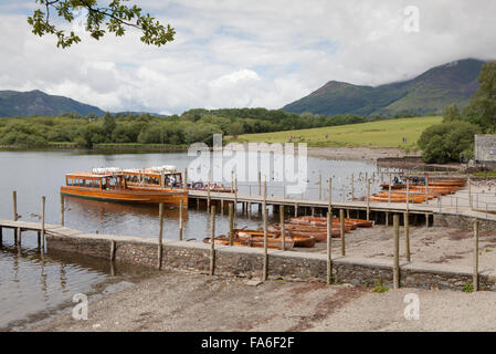 A launch and row boats are moored at Keswick boat landing on Derwentwater in the English Lake District - Stock Photo