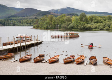A launch and row boats at Keswick boat landing on Derwentwater in the English Lake District - Stock Photo