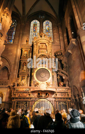 People looking at the Strasbourg Astronomical Clock dating from the 17th century, in Strasbourg Cathedral, Alsace, - Stock Photo
