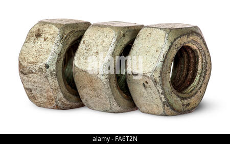 Three old rusty nuts in a row isolated on white background - Stock Photo