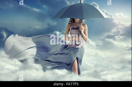 Attractive lady walking on the clouds - Stock Photo