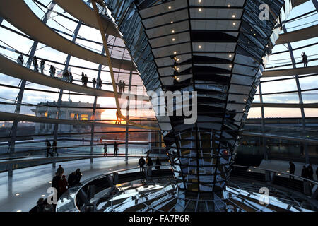 A sunset seen through the glass cupola of the Reichstag Building in Berlin, Germany. - Stock Photo