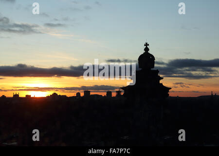 A sunset seen through the rain spotted glass cupola of the Reichstag Building in Berlin, Germany. - Stock Photo