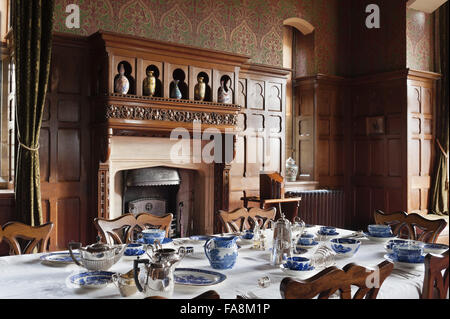 View towards the fireplace and overmantel in the Dining Room at Knightshayes Court, Devon. - Stock Photo