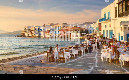 Outdoor restaurant, Mykonos Island Old Town, Little Venice in the background, Greece - Stock Photo